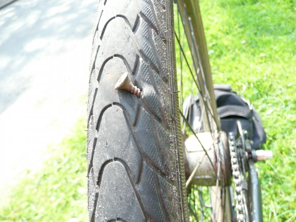 a screw in a bicycle tire